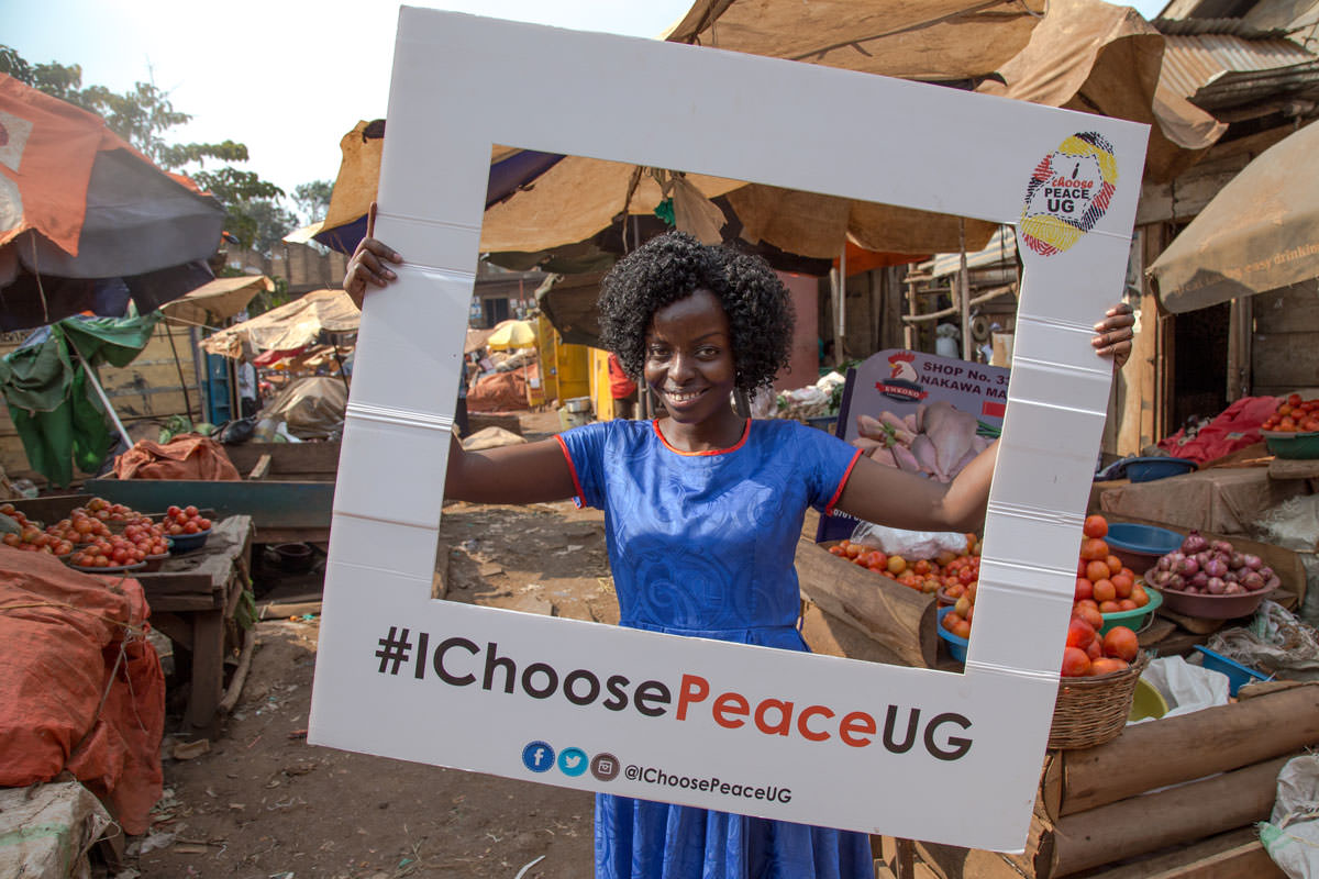 Desire Karakire, founder of #IChoosePeaceUG movement, visits Nakawa Market in Kampala to encourage citizens to contribute to a peaceful election.