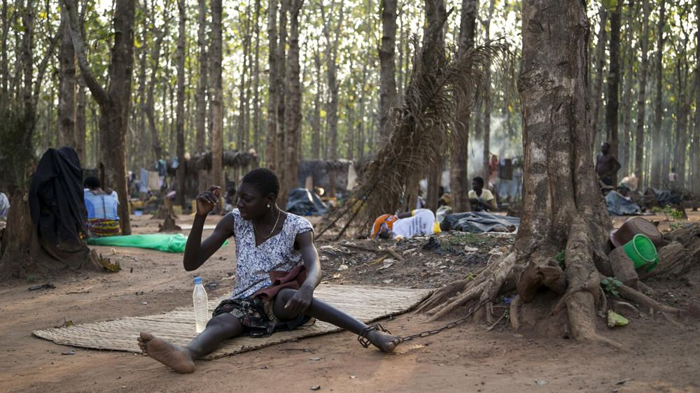 A PATIENT CHAINED TO A TREE AT JESUS IS THE SOLUTION PRAYER CENTRE IN TOGO.