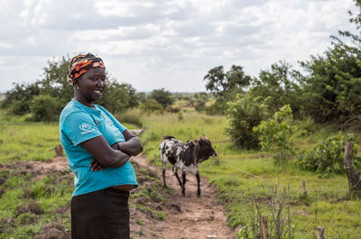 South Sudanese refugee Nyantet Malual, 28, purchased a cow with money she saved from farming on her small plot in Uganda's Arua district.)
